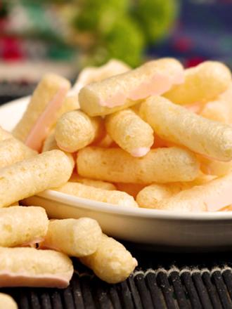 Snacks de Maíz recubiertos con Crema de Naranja